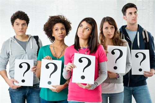 Students holding question marks